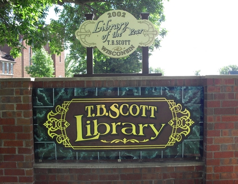 Outdoor T.B. Scott Free Library sign